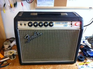 Fender Vibro Champ Amp from 1969. I'm sure true aficianados can chime in but I believe this style/era with the aluminum trim that goes around the grill cloth started in 1967 and ended sometime in 1969.