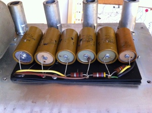 Old bulgy, leakey Mallory caps in the power supply needed to go. They are original and are still kinda working after about 45 years! The 4th from the left is visibly oozing it's electrolyte (an ionic conducting liquid)! Looking from left to right you can see the 4th and 5th cap have 235-7018A and 235-7015A (it looks like) printed on the paper covering, indicating they were manufactured during the 15th and 18th weeks of 1970.