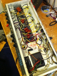 Looking down the chassis. Various cathode bypass capacitors were replaced as well as the 470 ohm screen grid resistors. One measured 390 ohms and the other was 712 ohms. There is a bias trimpot attached to the hum balance pot installed by some previous tech visible just to the left of the upside down