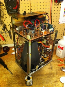 With the scope standing upright and the screen facing down you can see big CRT probably takes up half the space in the scope chassis itself. From this side view you can see the power supply on top, the vertical deflection board on the left behind the CRT and the horizontal deflection board on the right. These PCBs connect to the knobs and jacks and switches on the front panel that control your vertical and horizontal scales of the V/t graph. I cleaned all the pots and cleaned and retensioned the BNC input jacks on the front panel. Also re-soldered a bunch of connections where a knob or switch connects to the PCB. These solder connections are always problems in guitar amps because of all the jostling. So mostly just cleaning and touch up stuff for this BK. No parts were replaced.