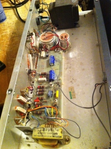 Not too much going on here, just needed a few new caps and a broken AC power cord replaced. Never found the schematic, but you could just consult the output section of one of the other Concert series amps of this era.