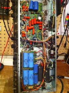 High tech amp. Has a simul-class power section which biases two power tubes in class A and two tubes in class AB through the same output transformer. SO, at idle two tubes bias at about 70mA and drop to 30-40mA when cranked (class A), while the other two idle around 30-40mA and rise to about 120-130mA when cranked (class AB). Also has half power option which, instead of limiting the power in the 4 tube simul-class output section, switches you over to another 2 power tubes. This amp had 6L6s for the simul-class section and EL34s for the half power option, although you could use 6L6s for the half power mode as well, from what I've read. A total of 6 power tubes in this amp