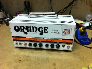 Orange Dual Terror just had a broken input jack. This amp is switch-able for 7, 15, or 30W and it sounds pretty nice. As far as I know, it is basically just the big brother of the Tiny Terror, having two channels rather than one and having four EL84s in the output section for 30W instead of 15W for the Tiny Terror, which only has two EL84s