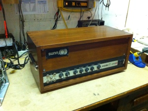 Re-housed 1st generation Sunn Model T from 1973. This is one of the loudest guitar amps ever. It uses an ultralinear output transformer because the output section is modeled after a Dynaco Mark III, meaning that the screen grid supply is fed through the output transformer as well as the B+ voltage -- the output transformer is a dual primary, one for the B+ and the other for the screen grid. Because the screen grid supply and the B+ come from the same power supply node their voltage fluctuates up and down under load together. This connection provides some feedback between the anode and screen grid and has been found to to act in a way that is between pure pentode mode and pure triode mode, with lower distortion than either.