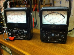 Can't get enough vintage test equipment. I have been on a buying spree of old, old meters that may or may not work. I've been buying the cheapest ones on eBay. The one on the right is from eBay but actually the one on the left was given to me by me uncle and it works very nice.  Both are Simpson 260 series 7 analog VOMs. The one of the left is the 7P version. The main difference I can see is that it has a push button reset switch in case of overload rather than a fuse. The meter on the right is a series 7M which has fused overload protection and the nice feature of a mirrored panel display to eliminate parallax error. Allows you to view the needle and interpret the reading on the display accurately from an angle. I am making a rough estimate but I think the Simpson 260 Series 7 was made between about 1975 and 1985 in Elgin, Illinois.