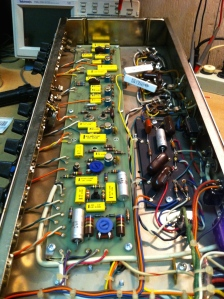 solid state preamp drives the 12AX7 phase inverter. Not sure what year it switched over but I know the earlier versions had the 12AX7 phase inverter and the later ones had a solid state one. Bias trimpot is visible right up front between the two big 620 ohm/2W resistors