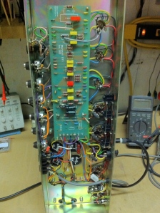 Seems like these amps are known to squeal when the volume and tone knobs are cranked really high. In my limited experience a 1000pF/.001uF cap across V2A's plate resistor will rid that. V1A's 68K control grid resistor is mounted on the PCB with a shielded cable going to the grid. I could still hear some radio coming through with volume cranked so I tried moving the grid resistor to the tube socket with good results.