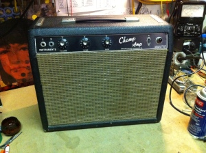 Old blackface Fender Champ. This amp is basically all original and still works good.  A 3-prong was added somewhere along the way and the