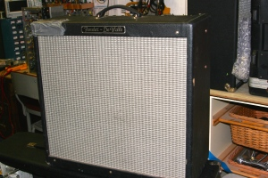 Fender Hot Rod Deville. This one had been through the shit. Power tubes were still functioning but were totally rattley. No doubt elements in the tube rattled loose from the vibration of the speakers. Lots of screws in the enclosure and screws holding the speakers were also loose, adding to the terrible rattley, distorted sound. Reverb tank didn't work and needed to to be replaced.