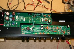 VHT Deliverance 60 and in the usual fashion VHT really likes to tell you a lot and even tell you off on the PCB. Has bias settings printed and various remarks on build quality/preference and other various things relating to tone mysticism. Pretty cool little amp. Has three preamp tubes with the third controlled in our out of the circuit by the More/Less switch. Does 60W with two 6550s/KT88s as the name implies. Looks neat and tidy.