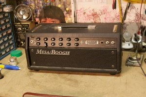 Mesa Boogie F-50. Seems like this is a little known amp. Has two 6L6GCs in the output section for 50W. Also comes in a four 6L6GCs F-100 version for 100W and a F-30 with two EL84s doing 30W.  I like how it's pretty stripped down and doesn't have a billion knobs and buttons and switches like a lot of other Mesas. Has a clean sound which people seem to claim is one of Mesa's best ever, and a gain channel with boost, so really only two channels. With the boost it gets pretty gainy, but doesn't quite reach into the gain territory of the rectifier series.  Had a string attached to the knob for what I would assume was a price tag. I should have removed it before taking the pic oh well.